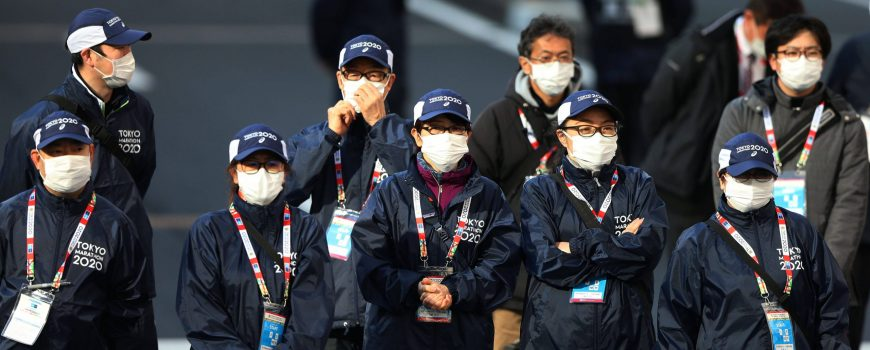 Official wear protective face masks as a precaution against the coronavirus, MARCH 1, 2020 - Marathon : Tokyo Marathon 2