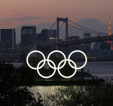 Coronavirus-forced postponement of Tokyo Olympics The Olympic rings are lit up in Tokyo s Odaiba waterfront area on Apri